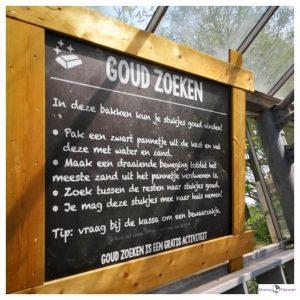 bord waarop staat Goud zoeken